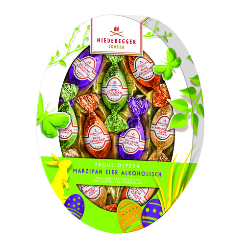 Niederegger Liqueur Marzipan Assortment in Oval Gift Box is an oval Easter Egg box containing 9 egg-shaped, chocolate covered marzipan enhanced with liqueurs, wrapped in brightly colored foil papers.