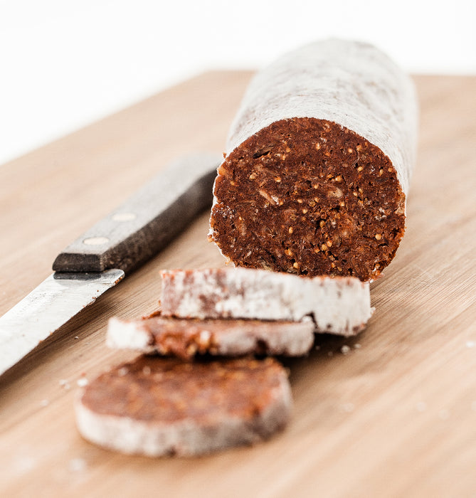 "Hellenic Farms Pistachio & Pepper Fig Salami is a vegan, 100% plant-based ""salami"" made with premium Greek Figs, Aleppo Pepper and Pistachios."