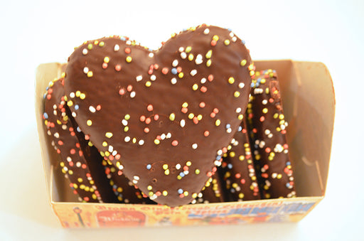 Wicklein Milk Chocolate Lebkuchen Hearts, known as Lebkuchenherzen in German, are heart shaped gingerbread cookies, covered in milk chocolate and studded with multi-colored nonpareils.