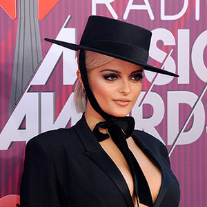 bebe rexha wearing felt bolero bijou van ness hat at iheart radio red carpet 2019