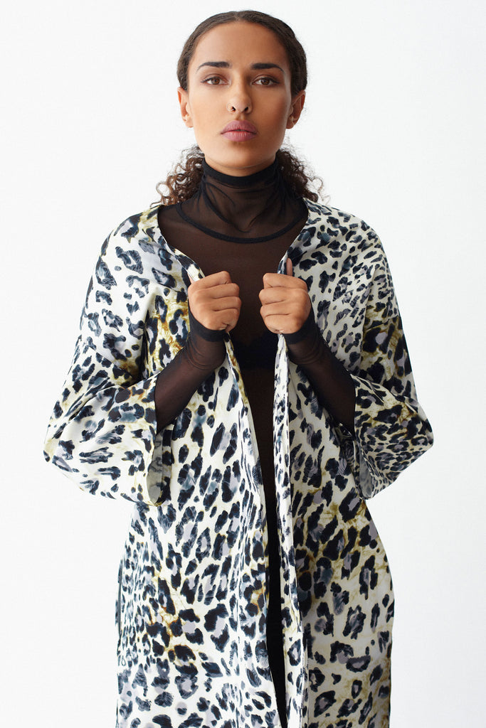 Close-up of KAI & KLO leopard print jacket.