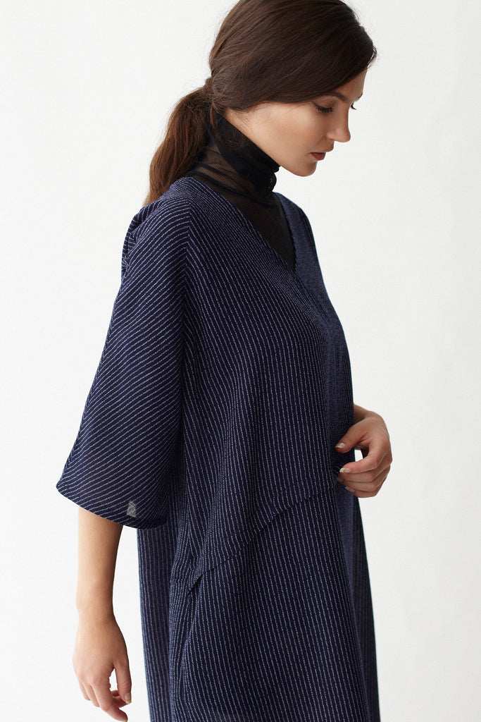 Close-up of KAI & KLO navy linen blend tunic dress with pockets.