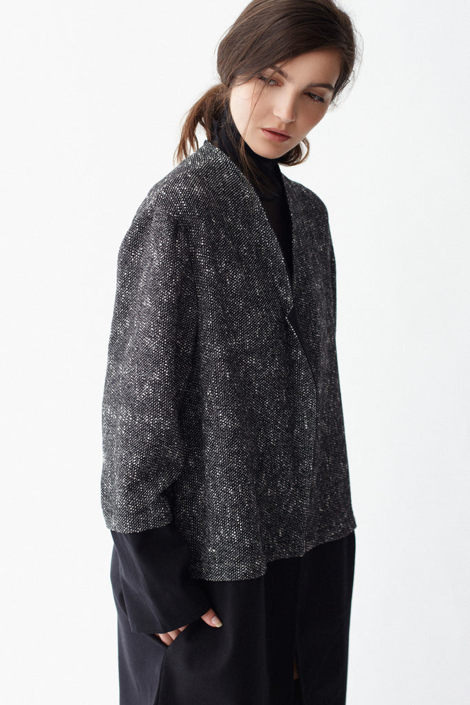 Close-up of KAI & KLO grey and black wool coat.