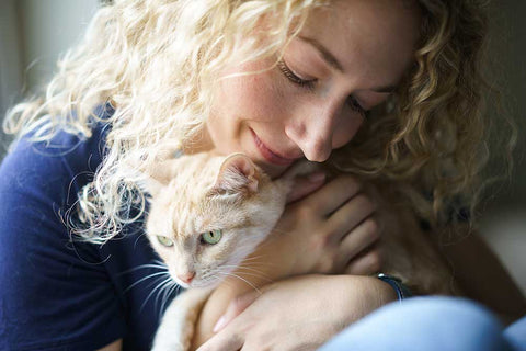 Americat Company founder Diane Danforth hugging her cat