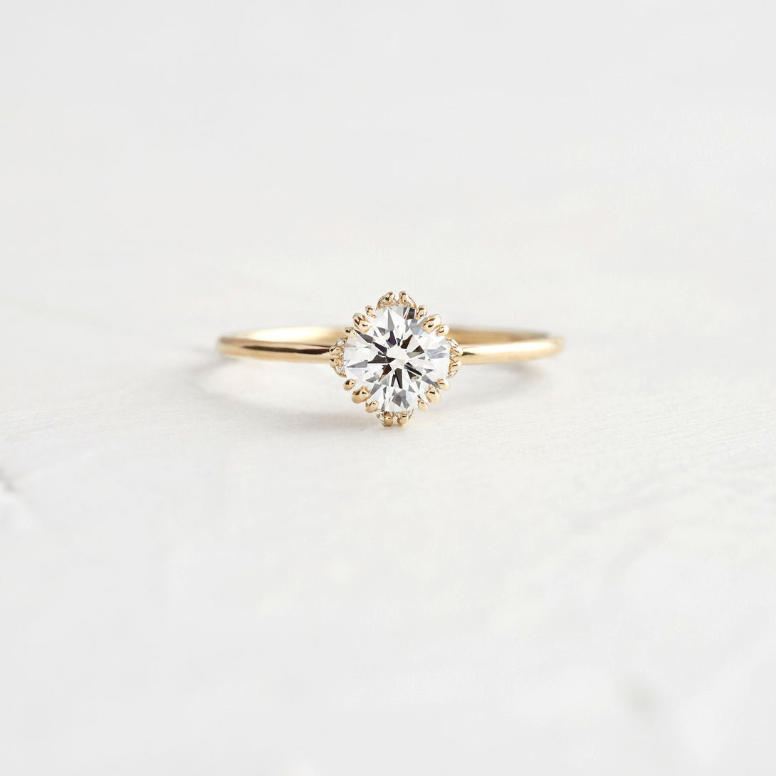 Unveiled Ring with Diamond Halo, 0.6ct.