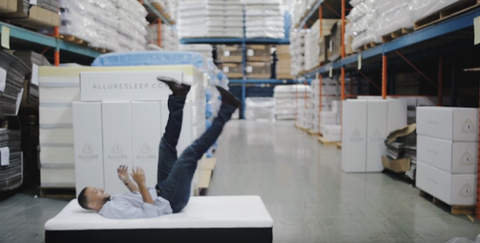 Man Jumping Onto Mattress