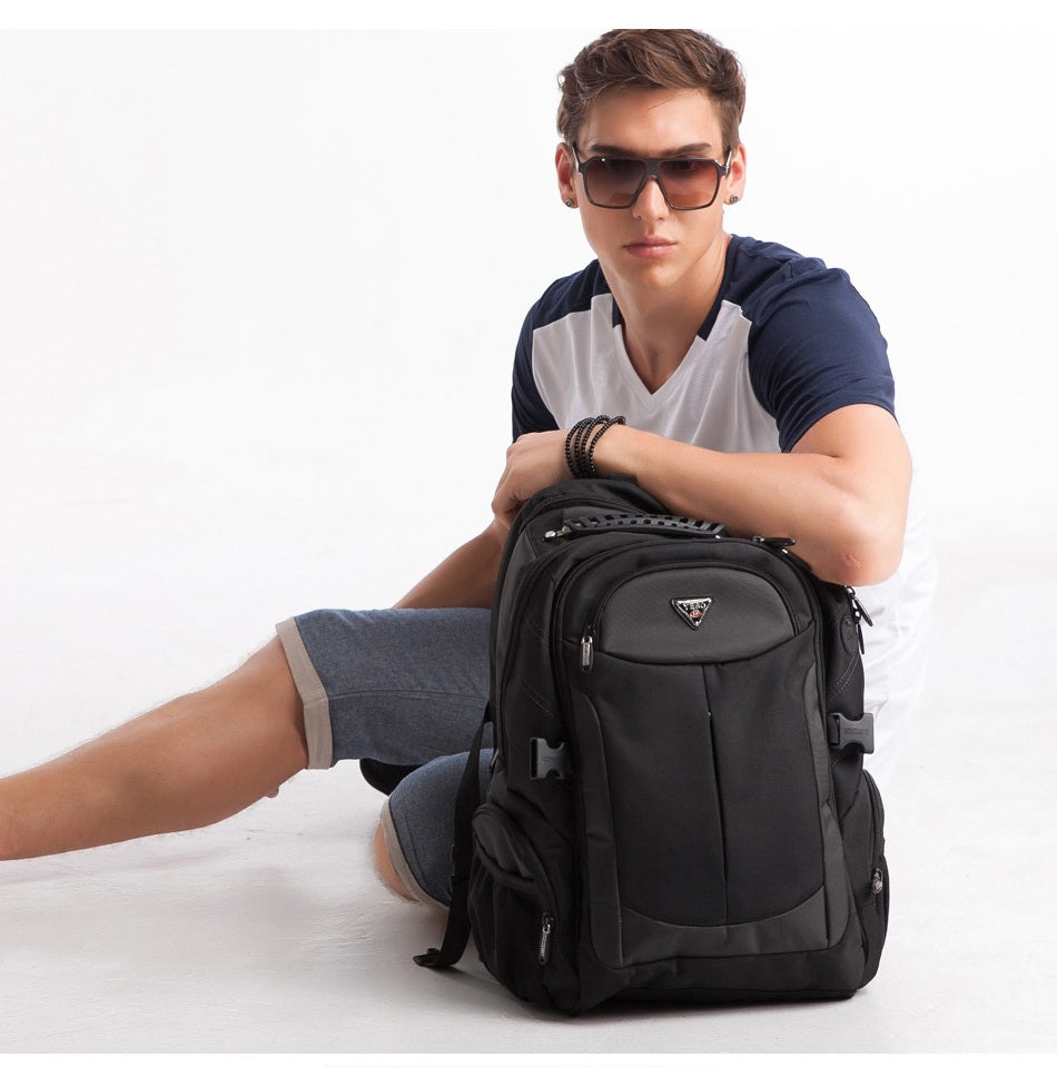 man sitting with large travel backpack