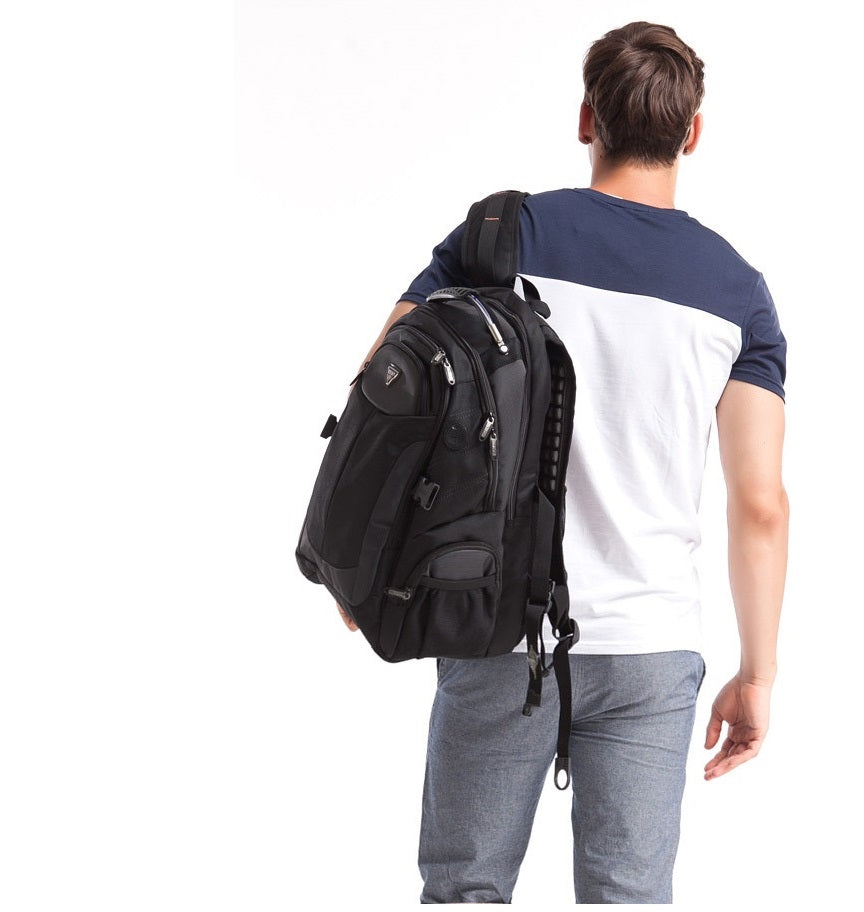 man standing with large laptop backpack