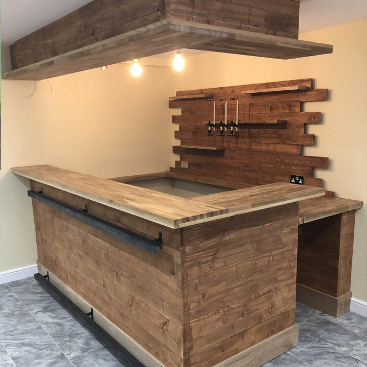 Large Split Level Home Bar Setup With Overhead Soffit