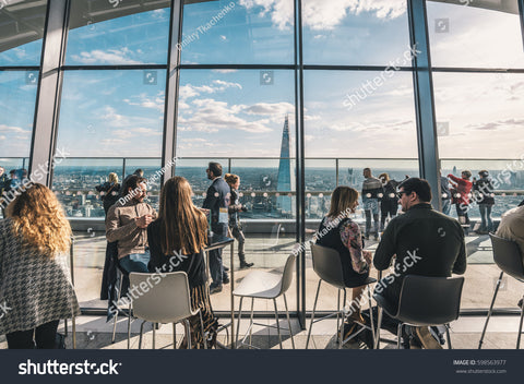 LONDON, UK - MARCH, 2016: People sitting in the Sky Garden, London's Highest Public Garden, known locally as the Walkie-Talkie located on the 20 Fenchurch Street.