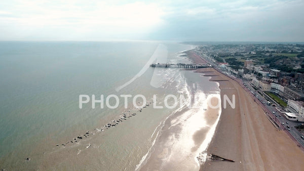 Hastings Beach and Pier Seaside Coast Aerial View 4K