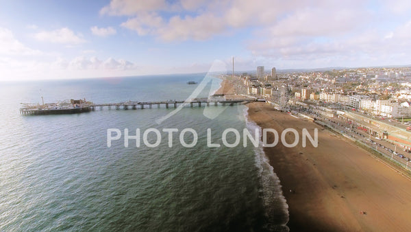 Aerial View Video Footage Of Brighton Pier, Sea And Beach UK