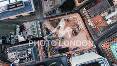 4K Aerial View Image Photo Flying Over A Construction Site and Cranes in Urban City Town with Buildings Development - UHD