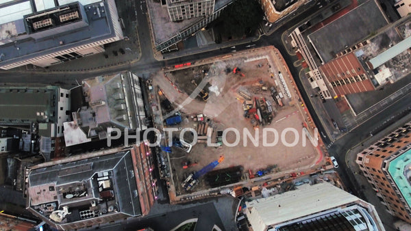 Aerial View Flying Over Construction Site Cranes In An Urban City Town