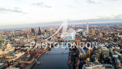 4K Aerial Helicopter View Image Photo London Skyline Iconic River Thames with Famous Skyscrapers in Financial District and Landmarks such as St Paul's Cathedral