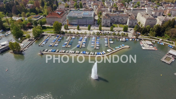 Fountain And Luxury Marina Boats In Zurich Aerial View 4K