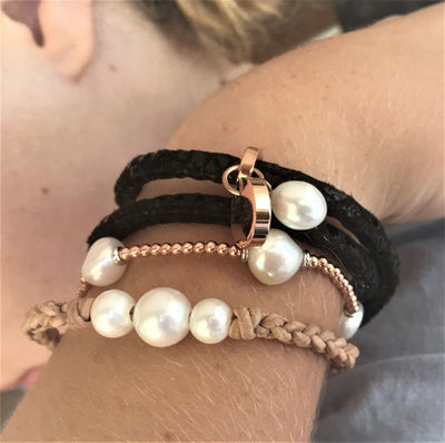 Leather and pearl combo of bracelets
