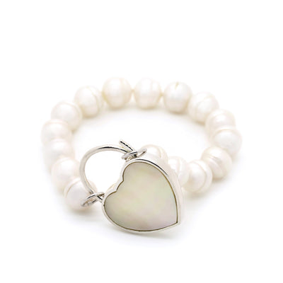 silver padlock and pearl bracelet