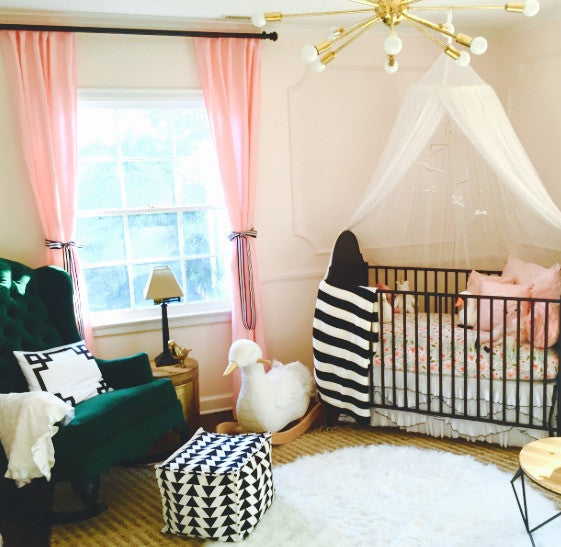 modern pink and green nursery with velvet wingback rocking chair