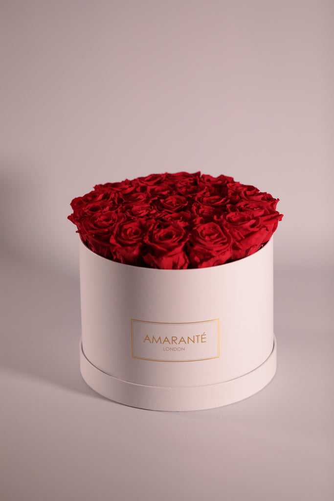 red forever roses in pink suede hatbox