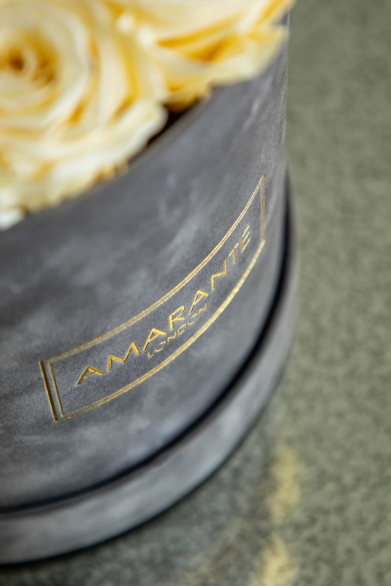 Detail of hatbox of preserved roses by Amaranté London