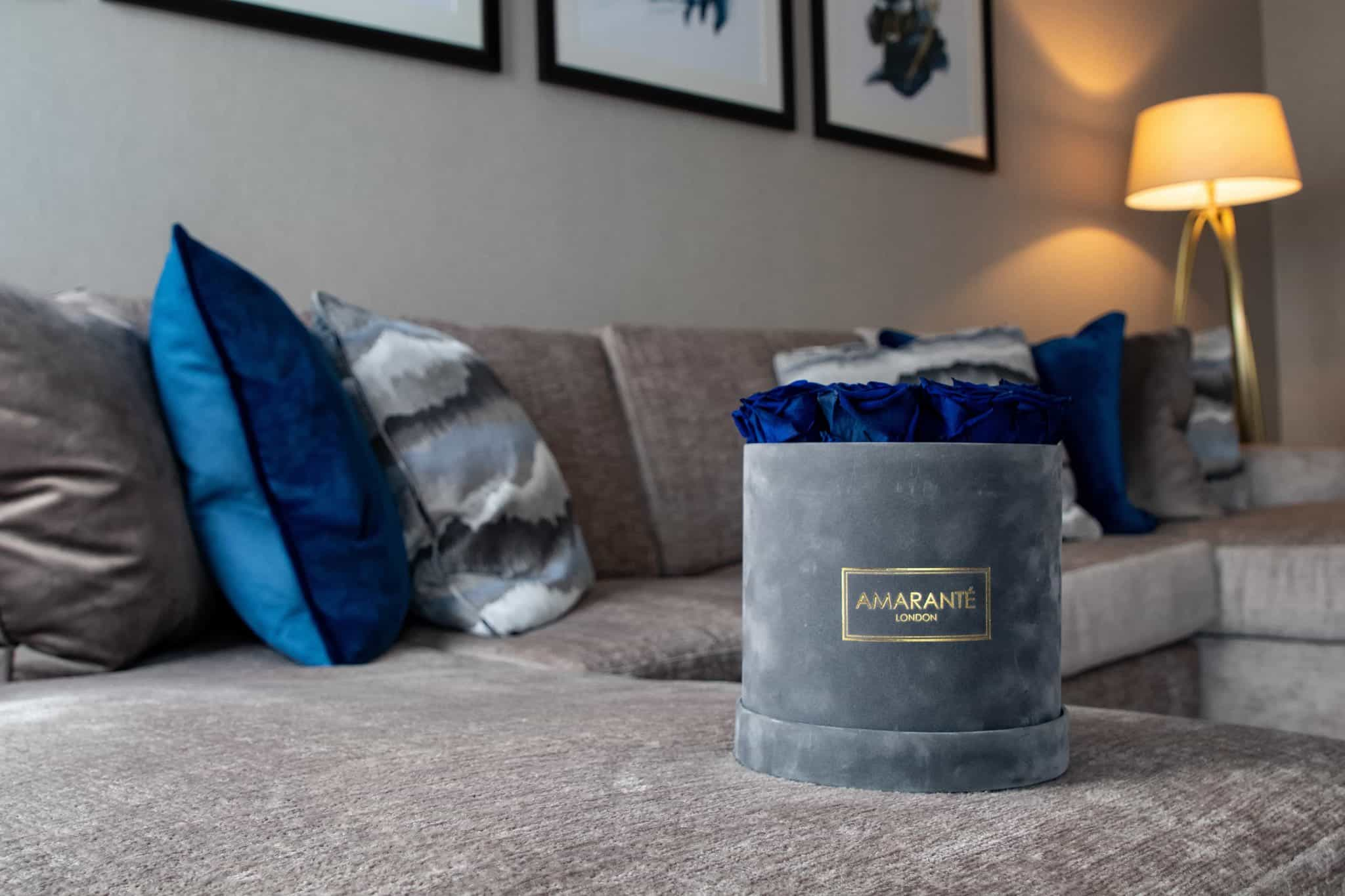 Blue Forever Roses in hatbox, extra large and luxurious grey suede.