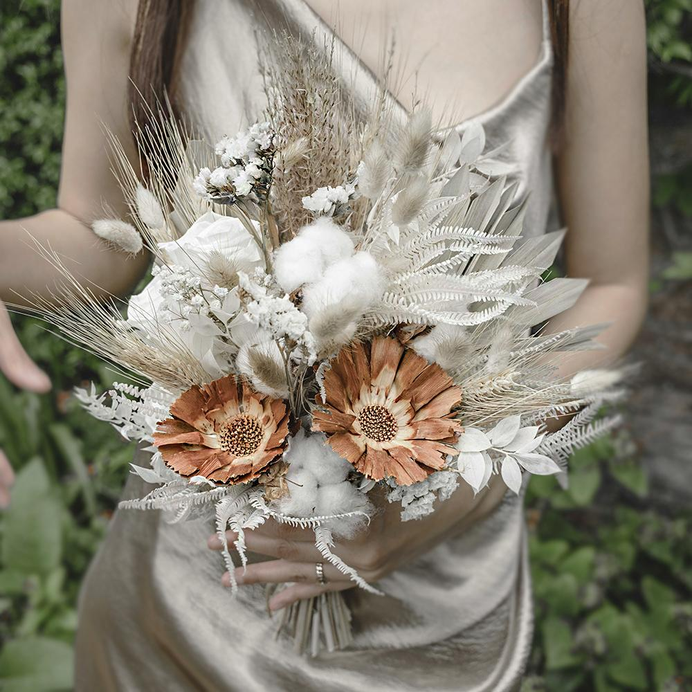Classic Bridesmaid Flower Bouquet bursting with cool green and warm orange stems
