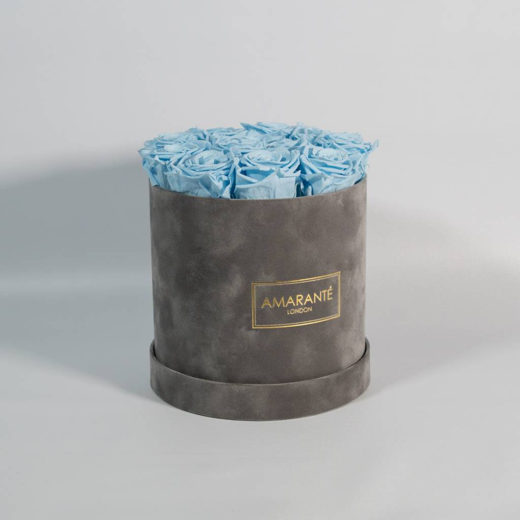 Enchanting birthday flowers infused with delicate blue petals in a sophisticated grey box