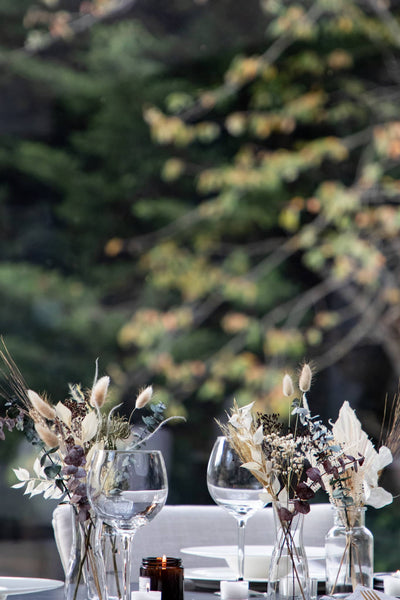 Rustic Meadow Bouquet on a lunch table in the garden