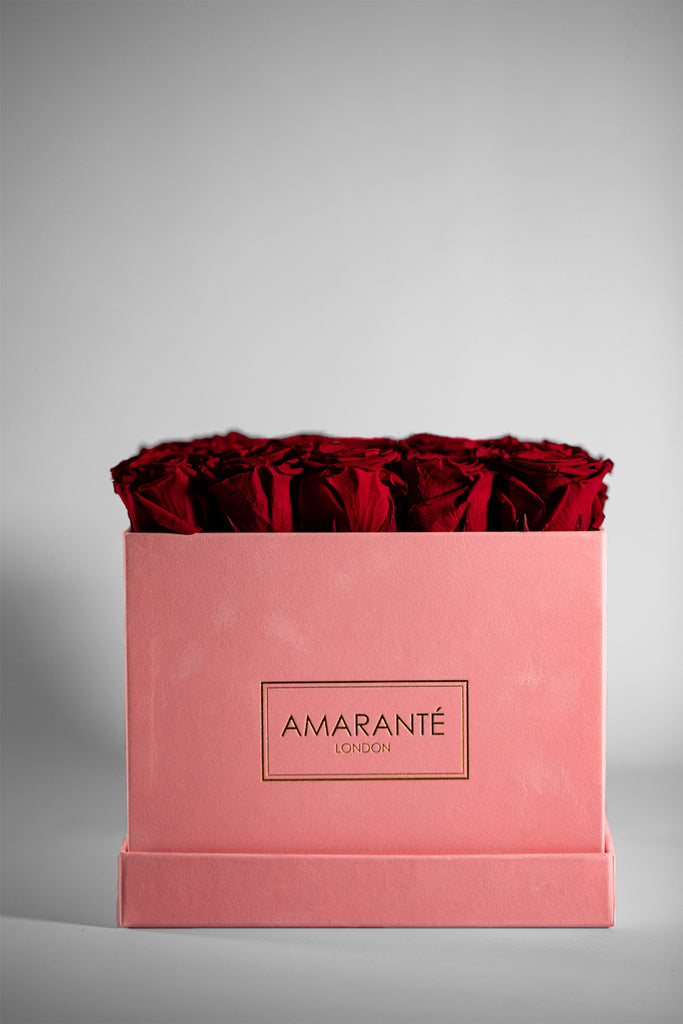 Red Roses in pink suede hatbox