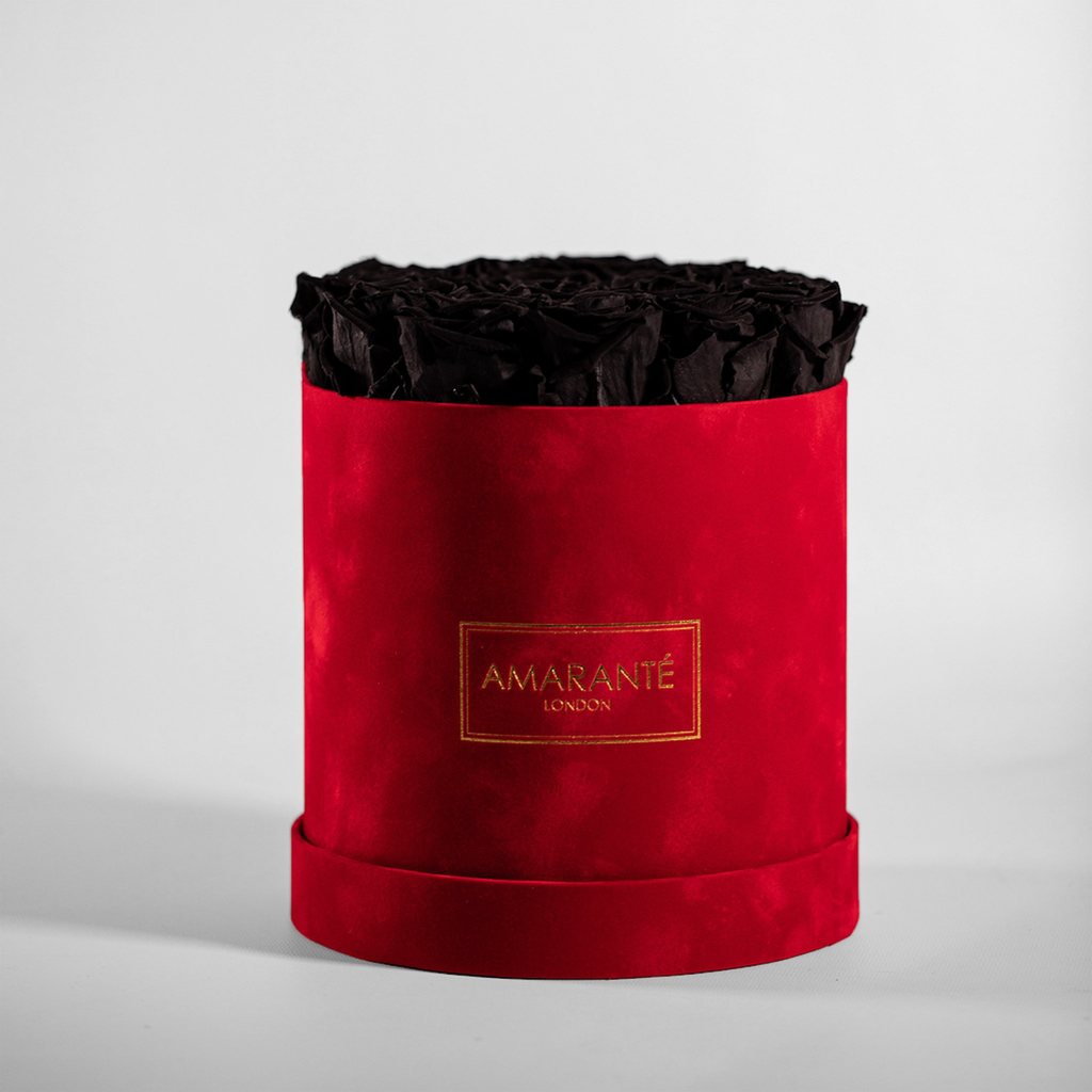 Black infinity roses in a medium size hatbox, luxurious red suede