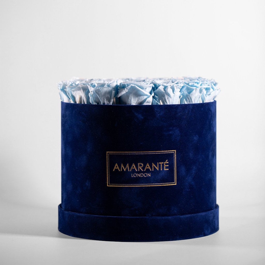 Image of a large blue hatbox with blue forever roses