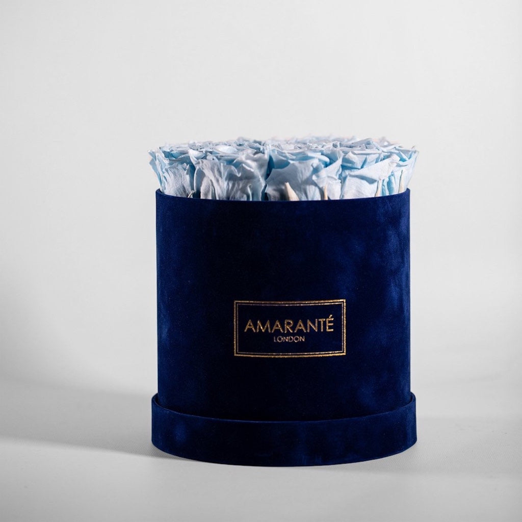 Image of a medium blue hatbox with blue forever roses