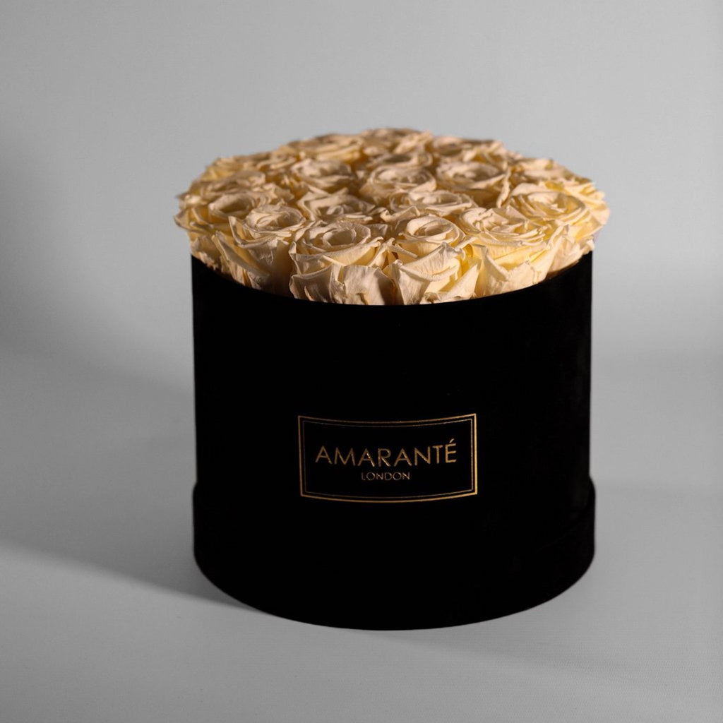 Eternal roses in a round black suede hatbox (Champagne coloured roses in medium size hatbox)