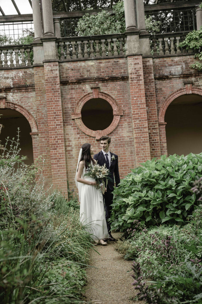Bride and Groom with stylish dried flower bouquet and buttonhole flower