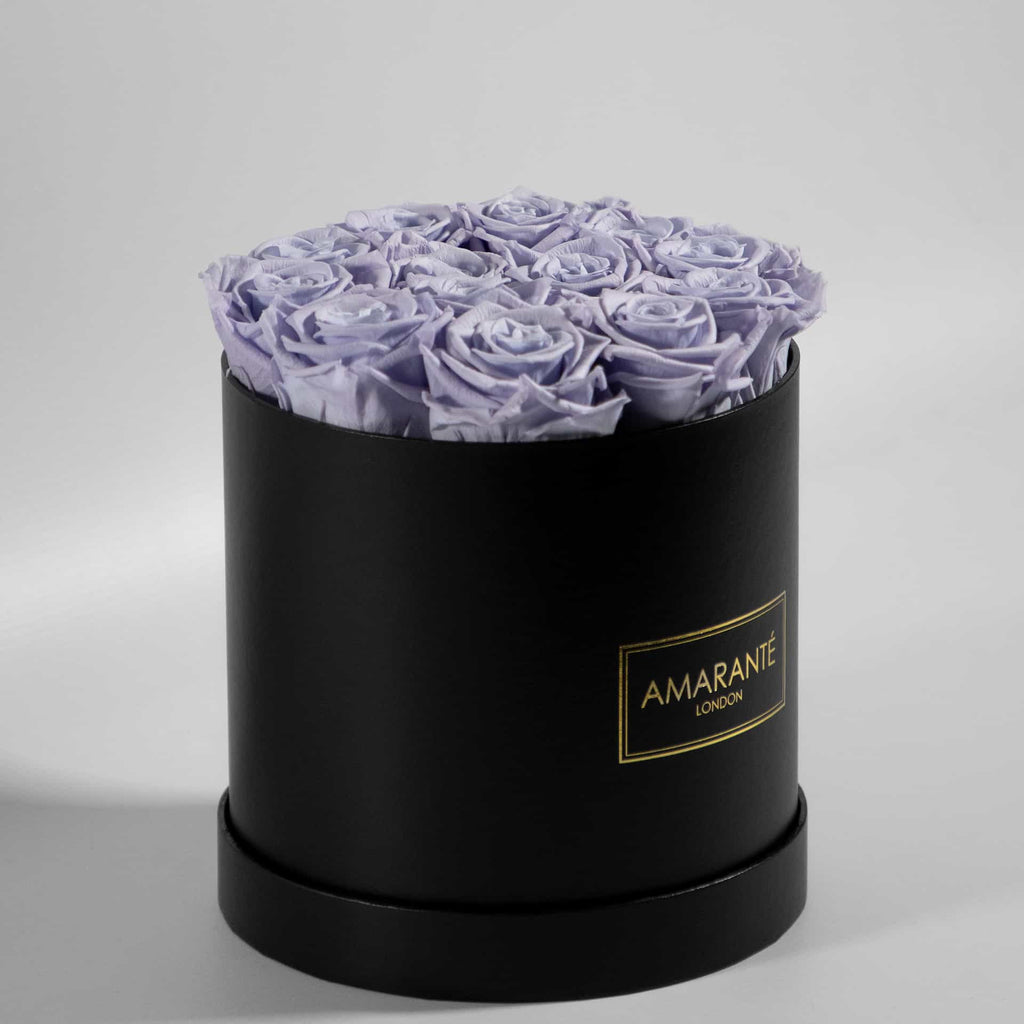 Lavender infinity roses in a hatbox, medium size