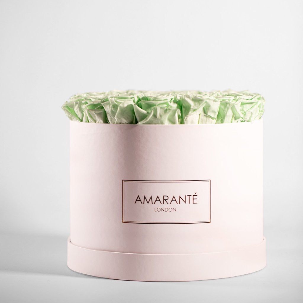 Mint green forever roses in a large hatbox