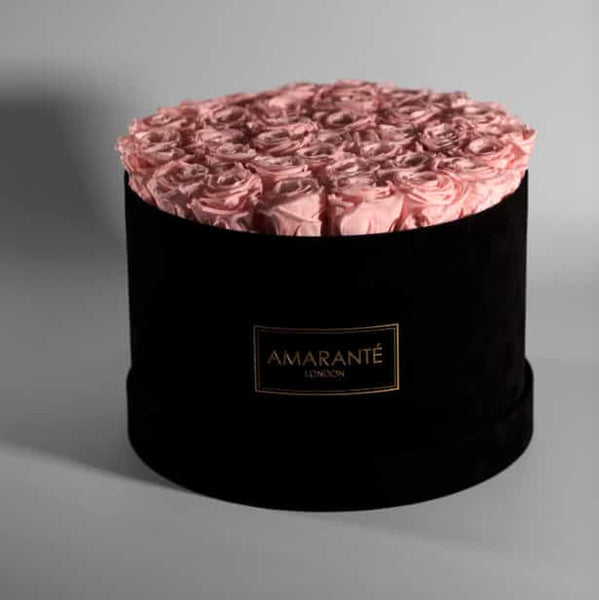 Pink infinty roses in large black suede hatbox