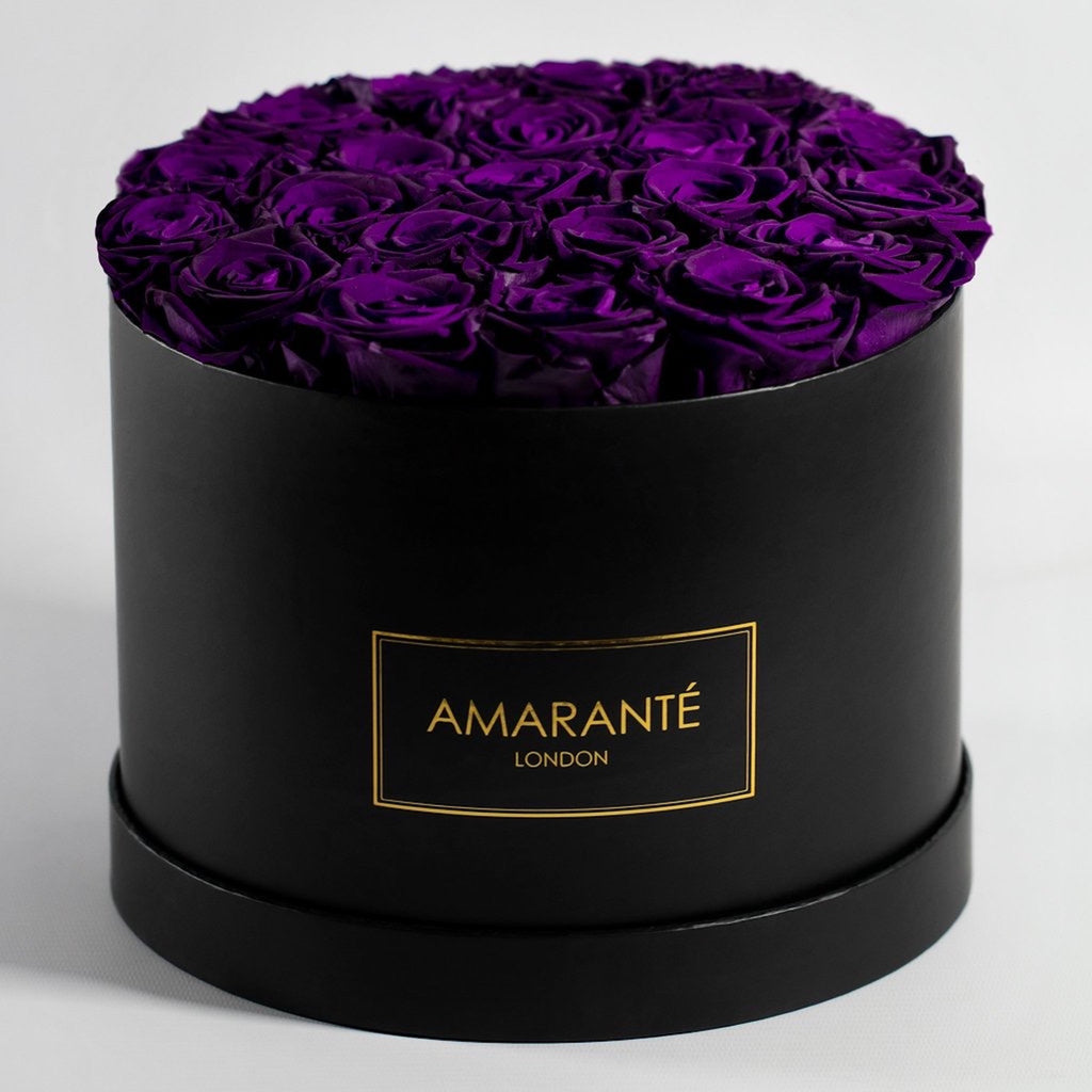Purple forever roses in a hatbox, large size