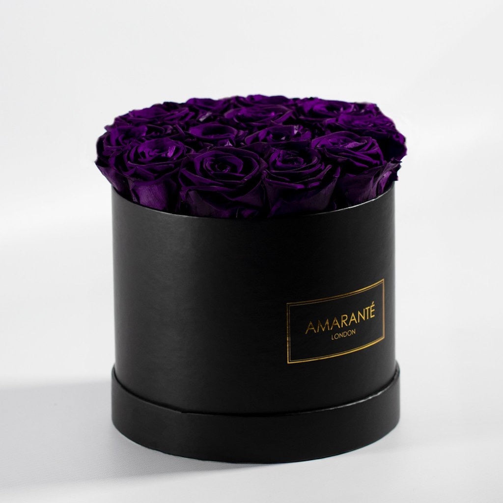 Purple forever roses in a hatbox, medium size