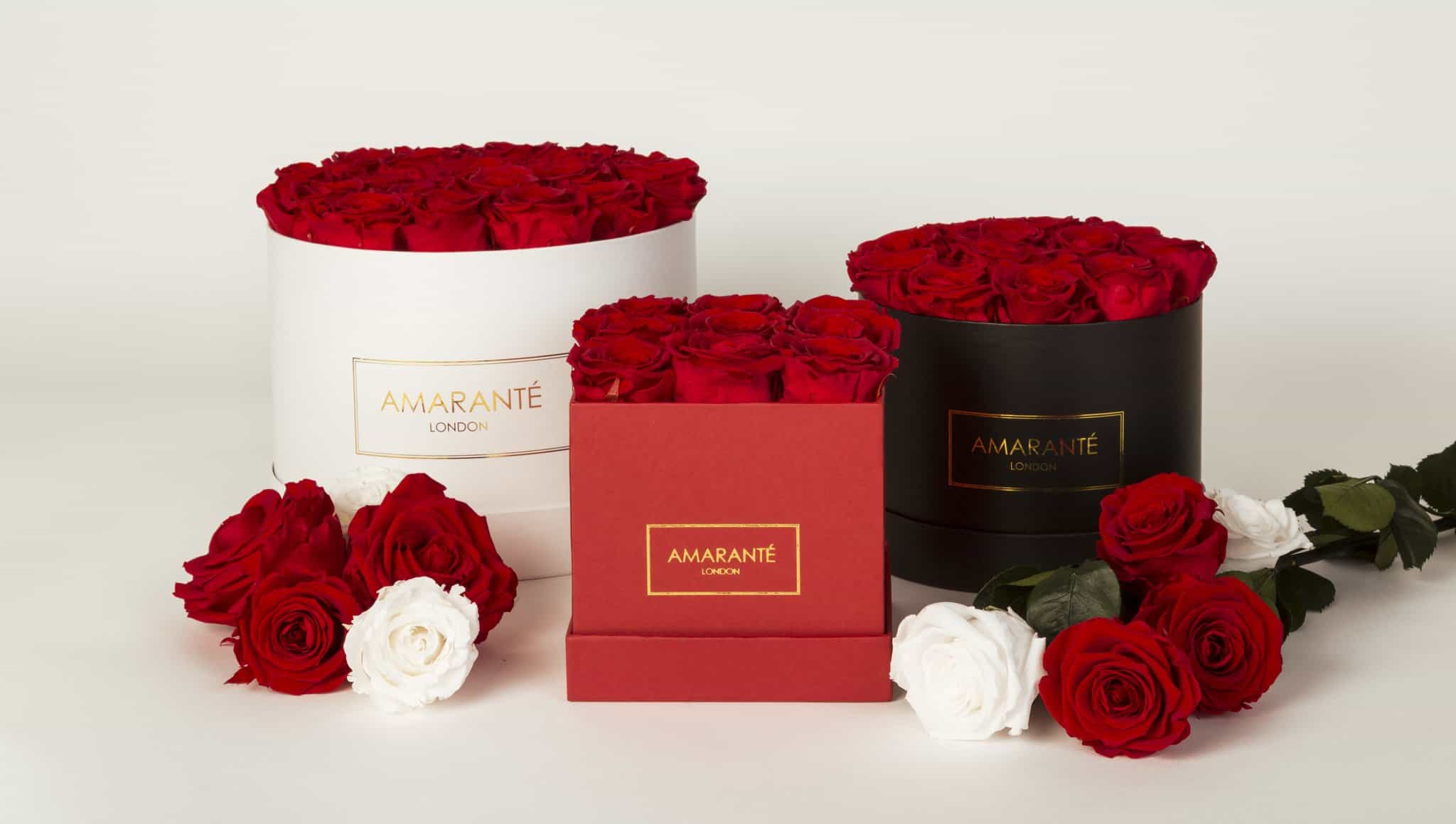 Red forever roses in a hatbox - Amaranté London