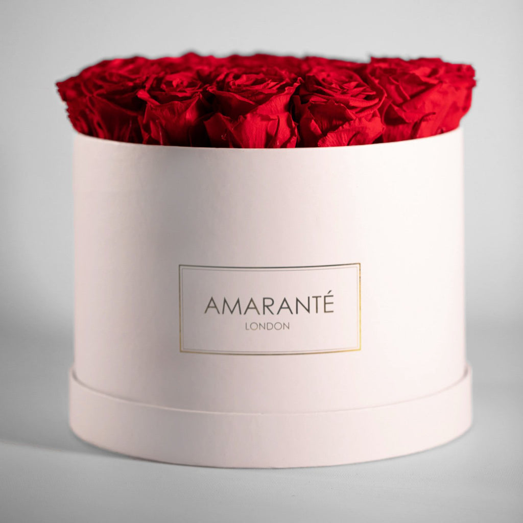 White large round rose box with red infinity roses