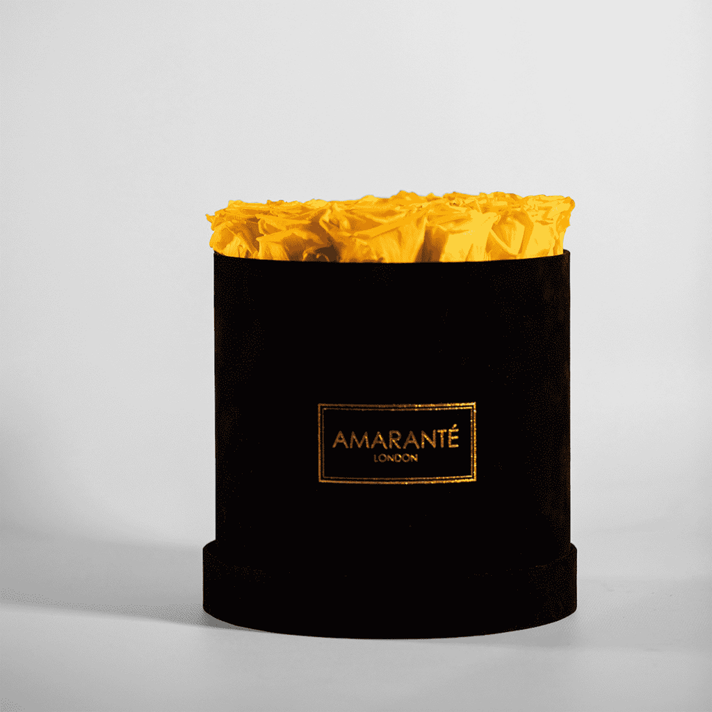Yellow preserved roses in an elegant black suede hatbox, large size