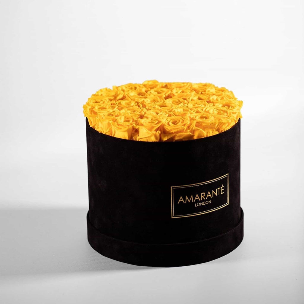 Yellow preserved roses in a black hatbox, large size
