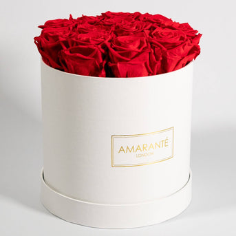 Fragrant red birthday flowers infused with fiery petals in medium