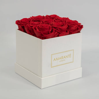 white square rose boxes, medium sized containing 15 preserved roses