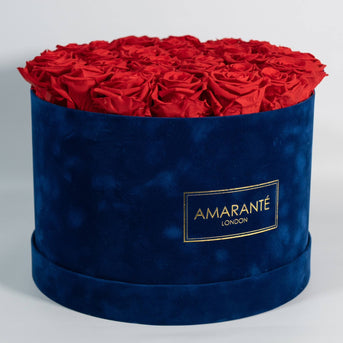 Beautiful Red Roses in blue round suede hatbox
