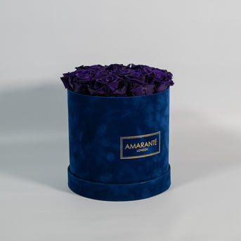 Purple eco flowers, roses in classic royal blue hatbox