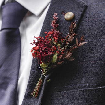 Captivating adore you flowers buttonhole from the adore you collection infused with vibrant red and classic black stems