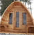 Dundalk Leisurecraft Knotty Cedar POD Sauna with Wood Burning Heater,  2' Porch, Bevel Siding, & 2 Front Windows